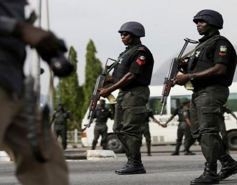 Breaking News: Suspended NHIS Executive Secretary Escorted into the Premises by Tear Gas Firing Policemen